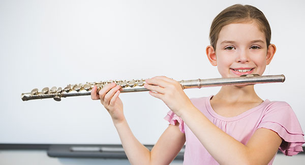 5th grade girl practicing for band