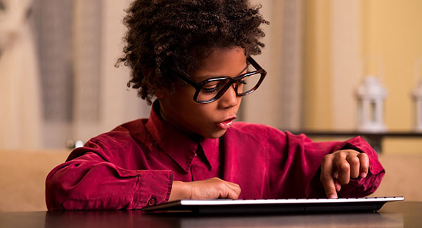Elementary school student on tablet device